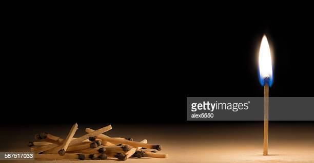 Pile of burnt matches laying down in front of one