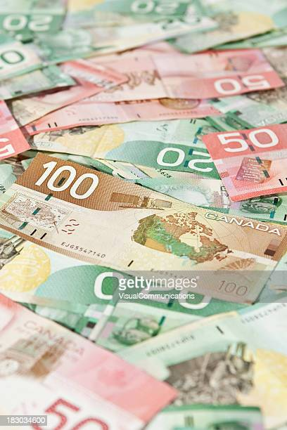 a pile of canadian bills of 20s, 50s and 100s - canadian currency stock pictures, royalty-free photos & images