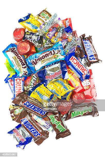 pile of candy on white background - pile of candy stock photos and pictures