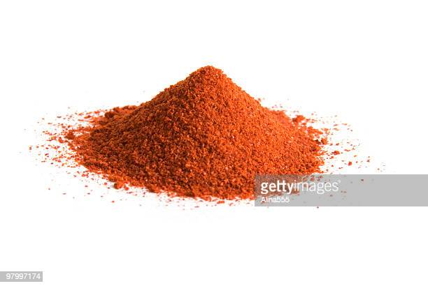 pile of cayenne pepper on white - red chili pepper stock pictures, royalty-free photos & images