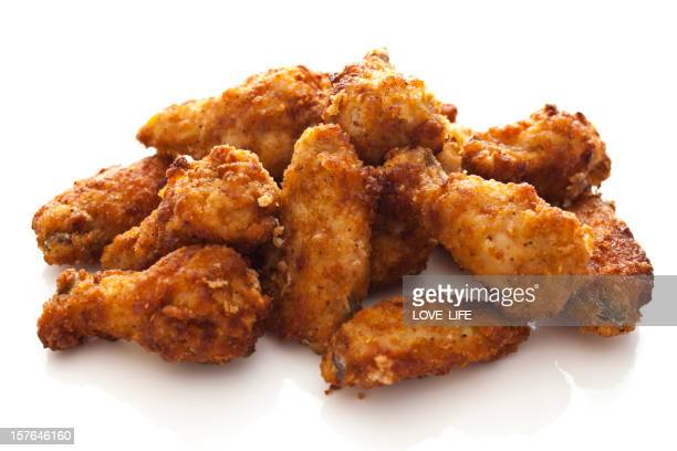 Pile of chicken wings on a white background