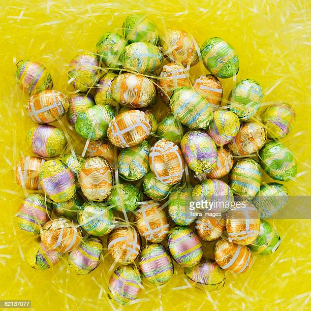 pile of chocolate eggs - easter candy stock pictures, royalty-free photos & images