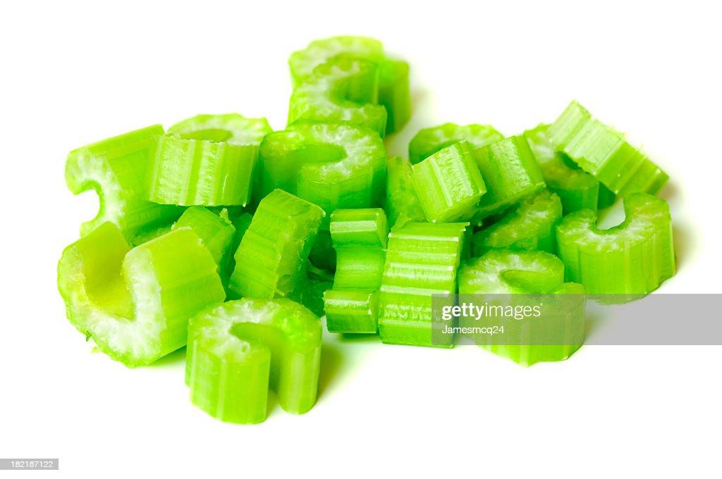 Pile of chopped celery isolated on white background : Stock Photo