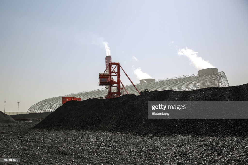 A pile of coal sits at the Sahiwal coal power plant owned by China`s stateowned Huaneng Shandong Rui Group in Sahiwal Punjab Pakistan on Wednesday...