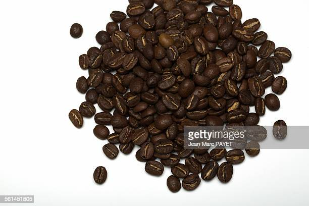pile of coffee beans on a white background - jean marc payet stock pictures, royalty-free photos & images