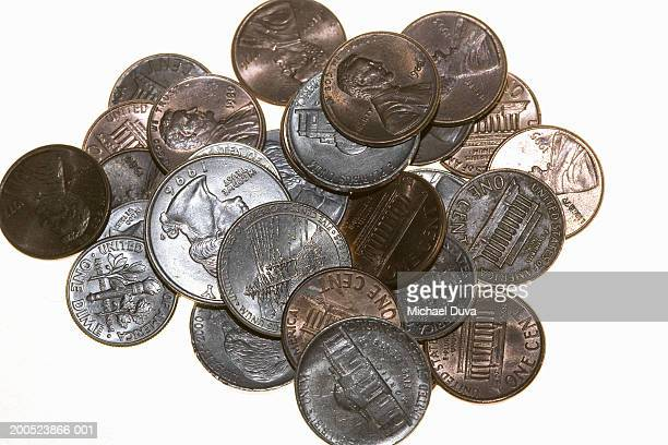 pile of coins - dime stock pictures, royalty-free photos & images