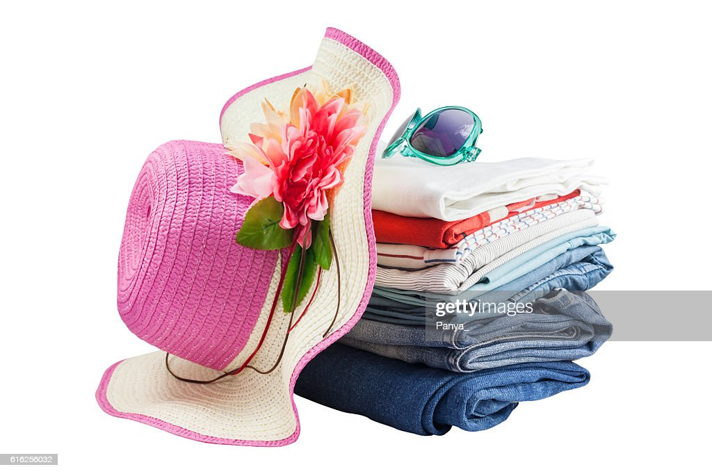 Pile of colorful clothes and Beautiful summer hat ,sweet beautif : Foto de stock