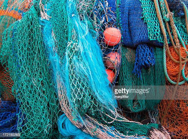 A pile of colorful fishing nets with ropes