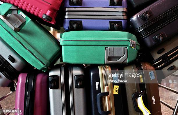 Pile of  colorful luggages