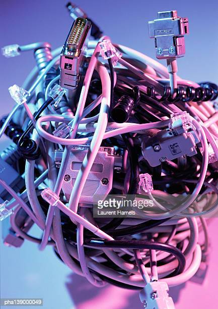 Pile of computer wiring and plugs, close-up.
