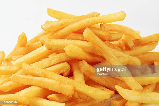Pile of cooked French fries on a white background