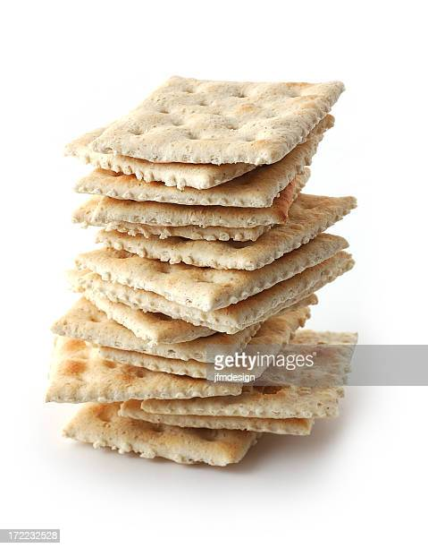 A pile of crackers on white background