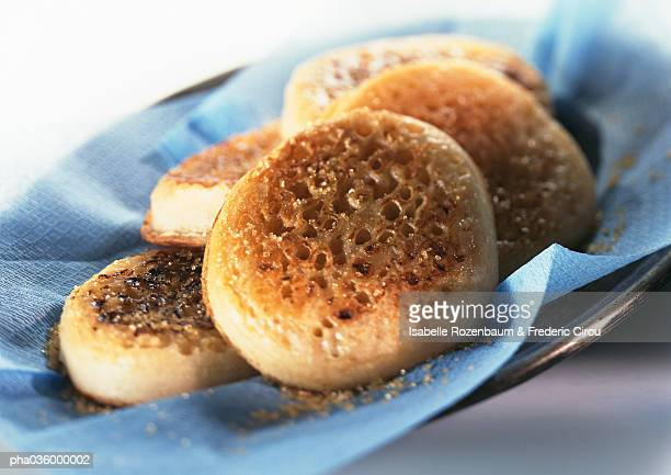 Pile of crumpets on blue paper, close-up