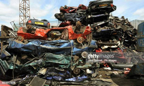 A pile of crushed cars piled high in a breaker's yard in Neasden north west London where Metropolitan Police officers checked cars in a breaker's...