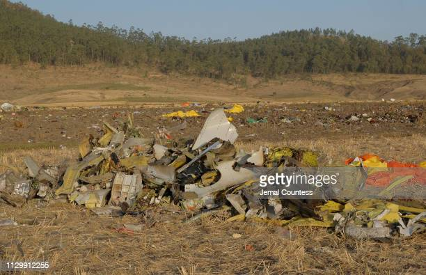 A pile of debris gathered by workers sits in the debris field during the continuing recovery efforts at the crash site of Ethiopian Airlines flight...