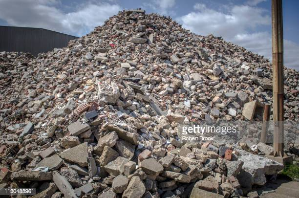 pile of demolition rubble - demolishing stock pictures, royalty-free photos & images