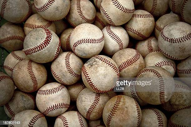 Pile of dirty and antique baseballs