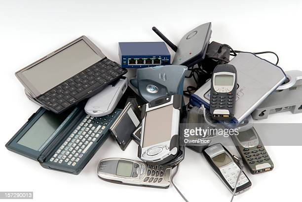 pile of discarded computers and phones - electronics stock pictures, royalty-free photos & images