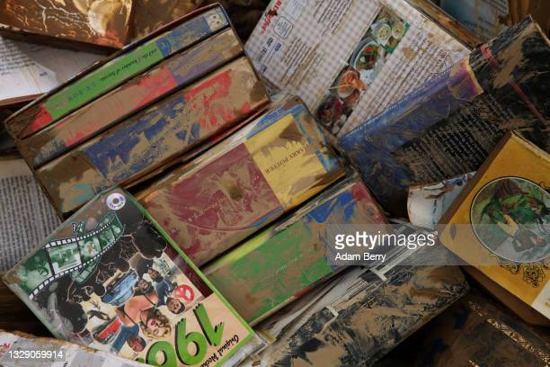 Pile of discarded damaged books, including several volumes of the Harry Potter series, is seen outside a private residence after a major flood in the...