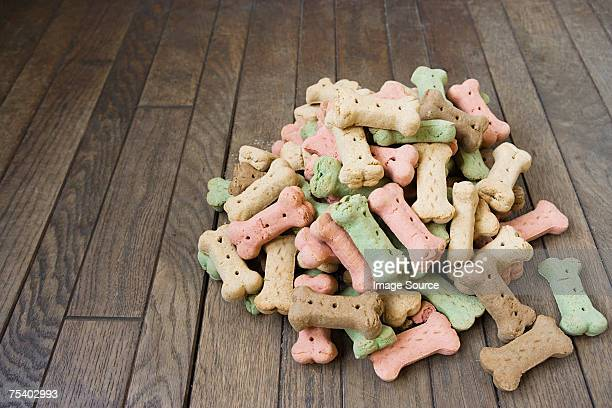 pile of dog biscuits - pet equipment stock pictures, royalty-free photos & images
