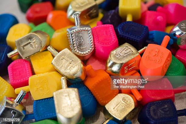 A pile of dreidels are pictured They will be given away at the event At the American Friends of Lubavitch in DC Rabbi Levi Shemtov and his staff are...