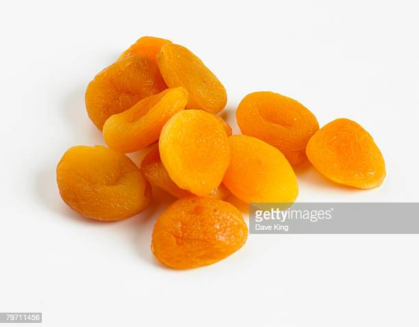 pile of dried apricots - apricot stock pictures, royalty-free photos & images