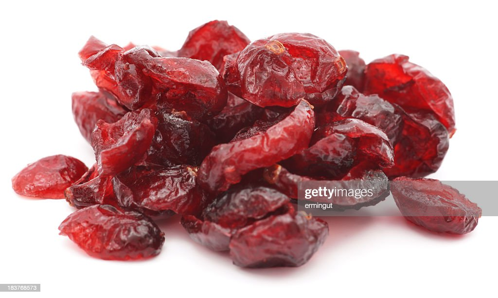 Pile of dried shriveled red cranberries on white background : Stock Photo