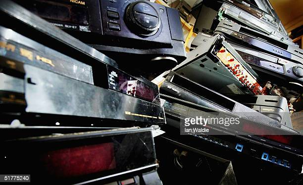 A pile of dusty and obsolete video recorder lies abandoned in a back room of a video repair shop November 22 2004 in London England Dixons the UK's...