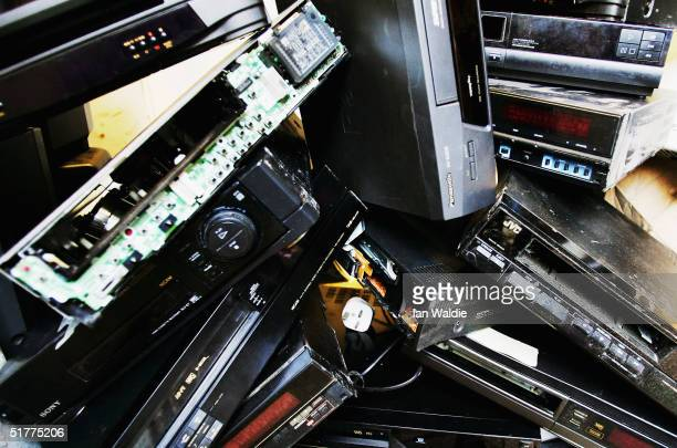 A pile of dusty and obsolete video recorders lie abandoned in a back room of a video repair shop November 22 2004 in London England Dixons the UK's...