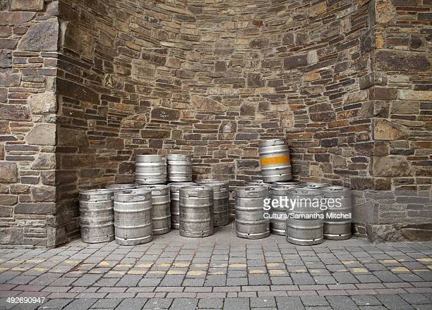 Pile of empty kegs outside a bar