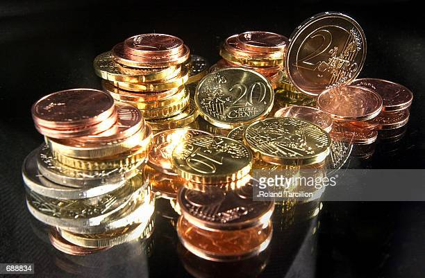 A pile of Euro coins are on display December 22 2001 in Stuttgart Germany Each European Union member country designs one side of the Euro currency it...