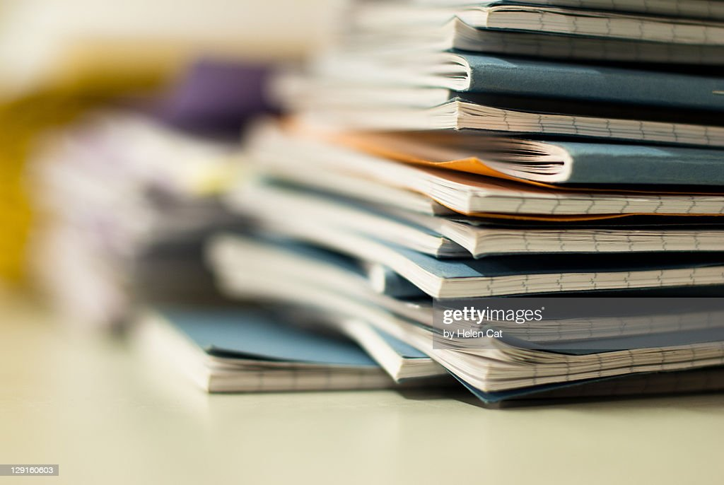 Pile of exercise books : Stock Photo