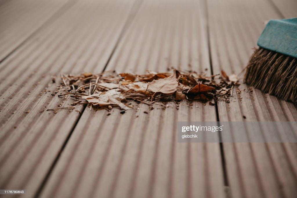 Pile of fallen leaves on floor of  veranda close up : Stock Photo