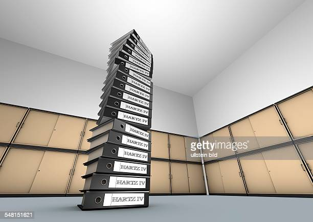 Pile of files with labelling Hartz IV in front of file cabinets