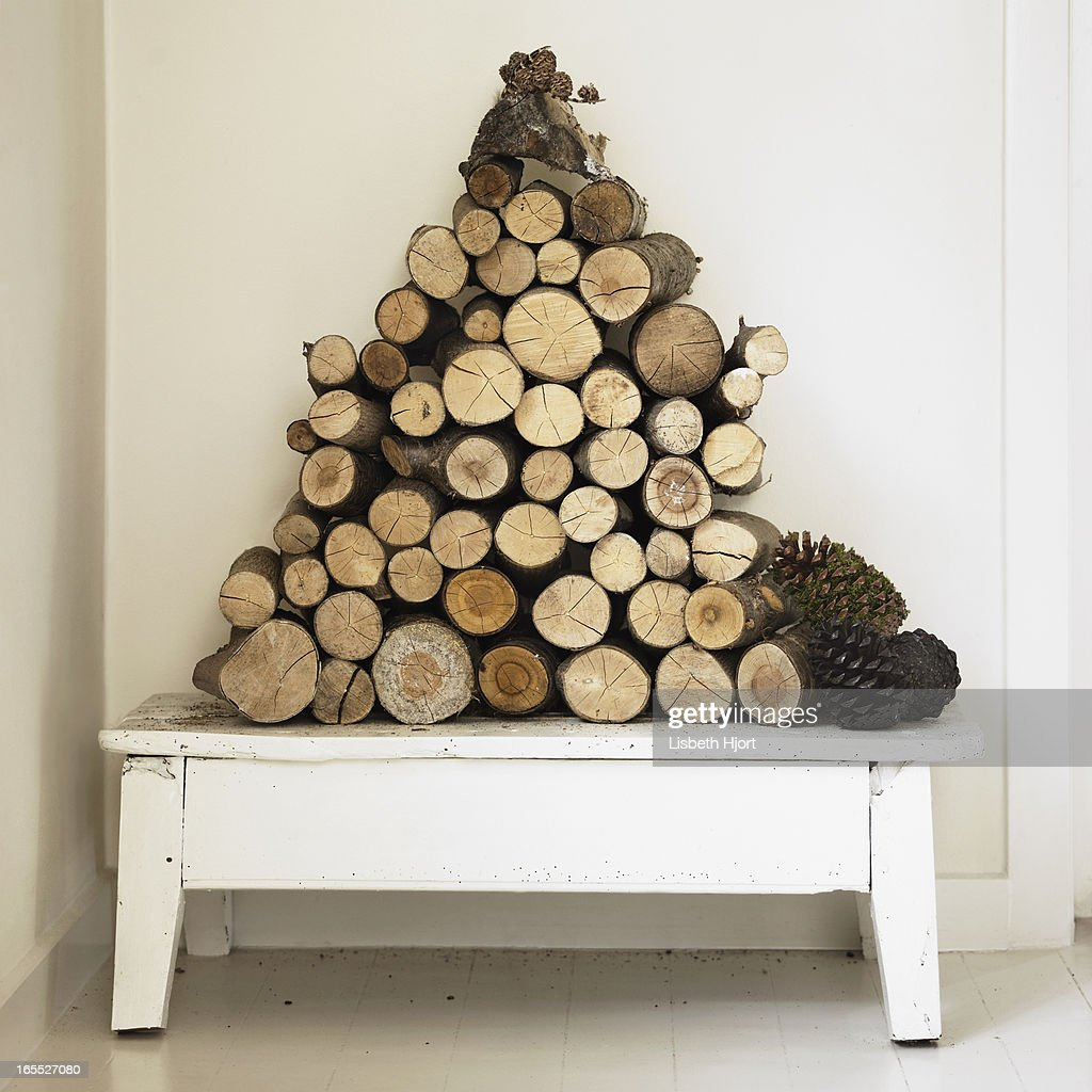 Pile of firewood on bench : Stock Photo