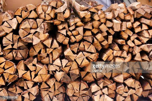 pile of firewood - firewood stock pictures, royalty-free photos & images