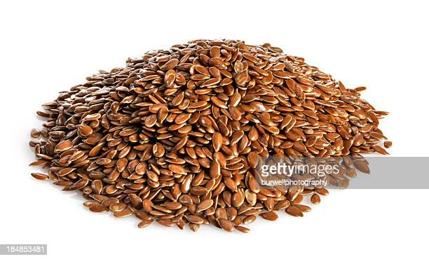 Pile of flax seed isolated on white
