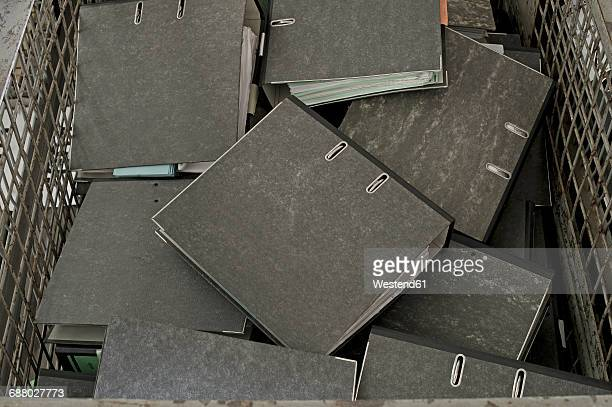 pile of folders in a container - bureaucracy stock pictures, royalty-free photos & images