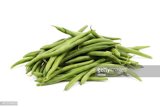 pile of fresh green beans over a white background - green bean stock pictures, royalty-free photos & images