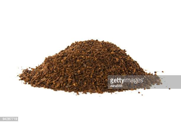 pile of fresh ground coffee on white - ground coffee stock photos and pictures