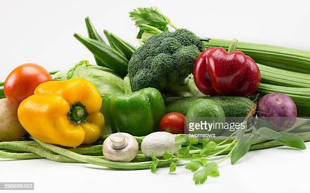 Pile of fresh vegetables on white background
