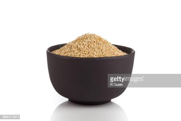 Pile of grain quinoa seeds in bowl