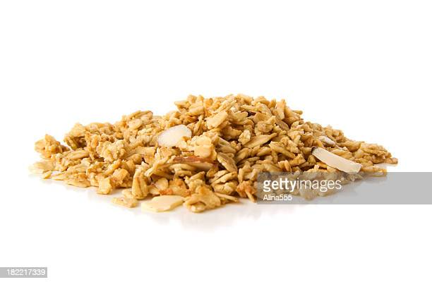 Pile of granola cereal with almonds on white