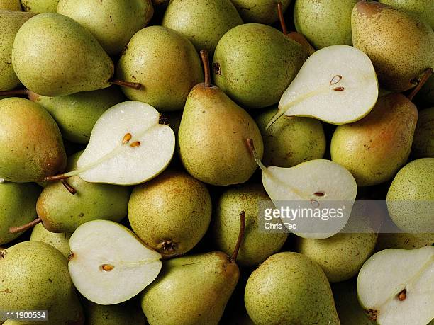 Pile of green pears with cut halves