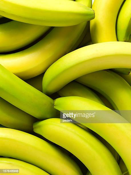 Pile of green tinted bananas in close-up
