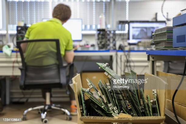 Pile of hash boards for repair inside the 3Logic mining equipment service center, in Moscow, Russia, on Wednesday, July 21, 2021. Bitcoinsteadied as...