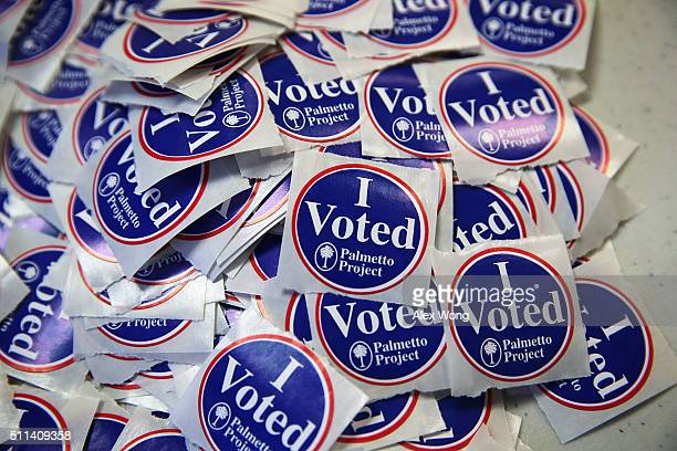 A pile of 'I Voted' stickers is seen at a polling station at Hand Middle School February 20 2016 in Columbia South Carolina Residents of South...