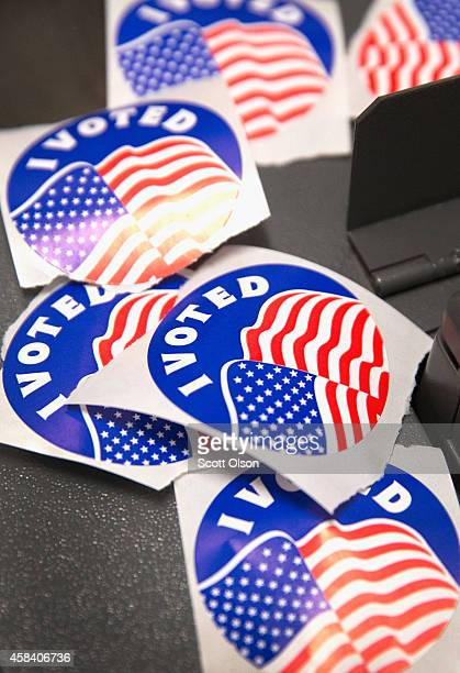 A pile of I Voted stickers which are handed out to residents after they vote sit on a voting machine at a polling place on November 4 2014 in...