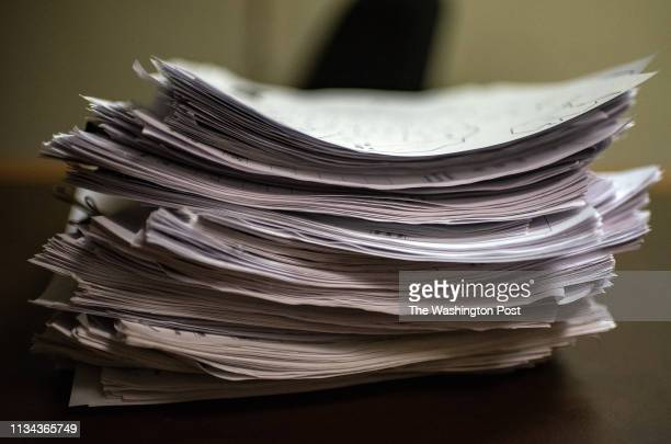 A pile of intake forms sit on a desk at a church being used as a makeshift shelter in El Paso Texas on Thursday March 28 2019 The The Annunciation...