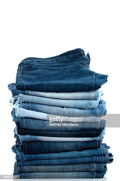 pile of jeans - trousers stock pictures, royalty-free photos & images